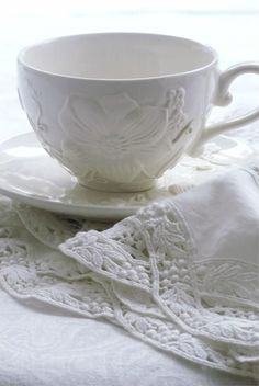 white china cup and saucer