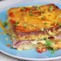 French toast gets a savory twist in this tasty breakfast bake! Made with ham, ch.French toast gets a savory twist in this tasty breakfast bake! Made with ham, cheddar, peppers and hot sauce to your liking, breakfast for the family just for a w Breakfast Dishes, Breakfast Bake, Breakfast Recipes, Breakfast Ideas, Breakfast Casserole, Breakfast Sandwiches, Savory Breakfast, Tasty Videos, Food Videos