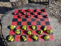 """How cute is this for an old stump? Paint on a checkerboard and paint garden-themed rocks as pieces. A whole new meaning to """"Go play outside!"""""""