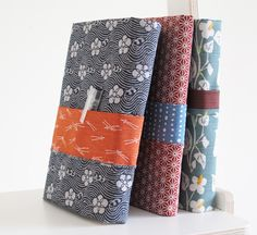 DIY instructions for a book cover from Ecoshiki; it does require different patterns for each side of your fabric for best effect.