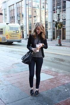 striped shirt. black blazer. jeans. black shoes.