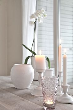 Beautiful centerpiece -- spray painted white candle bases & flower
