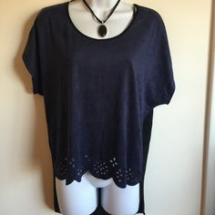 Brand new navy blue and black hi-lo top. Front Is a faux soft suede with cute detail cut outs in the bottom and the back is a t shirt material. firm unless bundled. Please no trades, modeling or other forms of payment. Thank you for understanding.  Rhapsody Tops Blouses