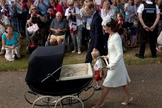 Kate Middleton, Prince William and Prince George of Cambridge arrive with Princess Charlotte of Cambridge