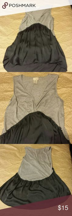 Grey high low tunic/tank Daytrip, grey, high low tunic/tank/ultra mini dress. Very soft. Excellent condition. Size small. Rounded hem in the back. Very interesting look. Daytrip Tops Tank Tops