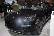 Video showed the  Porsche 911 Targa 4 GTS sports car zipping along snow-capped mountains as two models dressed in black and white peeled away a cover revealing the 50th anniversary 911 Targa model at the North American International Auto Show at Cobo Center in Detroit Monday.
