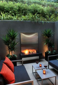 My style...clean, streamlined, modern, but cozy and not sterile Really cool outdoor fireplace with reflective metal back