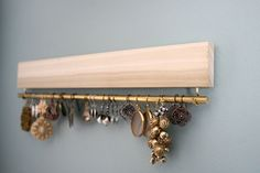natural wood and brass earring display and organizer by fairlywell