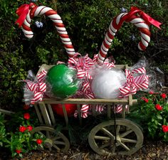 christmas wagon with goodies from the seasonal home find this pin and more on candy cane outdoor