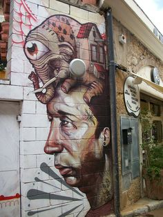 There's a house in a elephant in a octopus on a man's head?  Could only be the Dali museum, Spain  #streetart  #dali  #graffiti