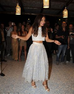 Princess for the day: Vanessa Hudgens was led into the centre of the room as festival goers took photos of her