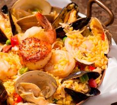 Calasparra Rica Dish with clams, mussels, scallops, Spanish chorizo, chicken, jumbo shrimp, crisp peppers, and green peas from The Wave Kitchen and Bar in Vero Beach, FL.