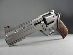 """Chiappa White Rhino 60DS-- an eccentric revolver from Italy.  6"""" barrel with M1913 Picatinny rails.  Holds six rounds of .357 Magnum (or .38 Special)  Handsome wood grips, flawless nickel finish, and adjustable fiber optic sights."""