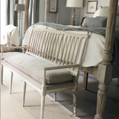 .love the way the cushion tie criss crosses around the settee leg
