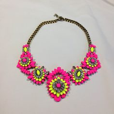 In Protest of everything you are supposed to believe about being a lady.  In Protest is a fashionista's dream. Neon fuschia and yellow colored rhinestones mixed with clear rhinestones in an aged gold setting. It's vintage and trend. High and low.   Amazing.  Necklace sits high on the collar... #SweetSangria #jewelry #trending #eyecandy #unique #boho #accessories #fashion #coolmom #womensjewelry