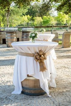 Wine barrels as high top tables for wedding reception / http://www.deerpearlflowers.com/outdoor-vineyard-wedding-ideas/