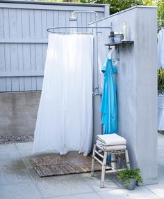 cheap outdoor shower...just get round rod and wooden bottom