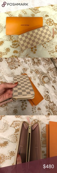 Louis Vuitton wallet -Model number is N61264 -holds 12 credit cards  - white checkered - still have the original packaging and receipt - worn two times Louis Vuitton Bags Wallets