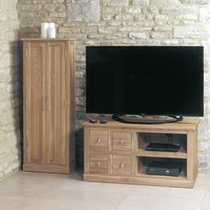 this contemporary mobel oak 4 drawer television cabinet is built from solid oak and designed to last a lifetime