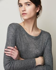 Neatly fitting, long sleeve tee in a soft, slightly sheer, wool/tencel jersey. Round neck. Raw edge cuffs and hem. For layering or as you will.