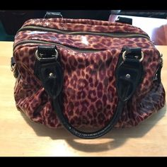 Bebe leopard print bag Leopard print with gold accents. 2 large zippers, big compartments. Good condition. bebe Bags Totes