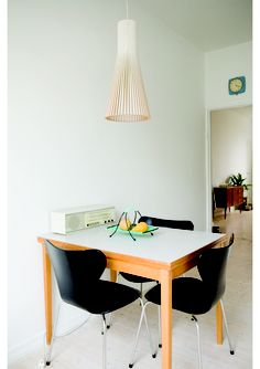 small dining: simple table, modern chairs, and an overhead lamp that wows!