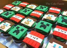 Chocolate cupcakes with Minecraft Creepers, Steve, and TNT fondant toppers....