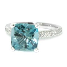 Surprise her this Christmas with a stunning aquamarine and diamond engagement ring. Our gorgeous Lumiere engagement ring is set with a cushion cut aquamarine, on a diamond encrusted white gold band. Custom Made Engagement Rings, Elegant Engagement Rings, Diamond Engagement Rings, Dress Rings, Quality Diamonds, Contemporary Jewellery, Ring Designs, Jewelry Design, Aquamarines