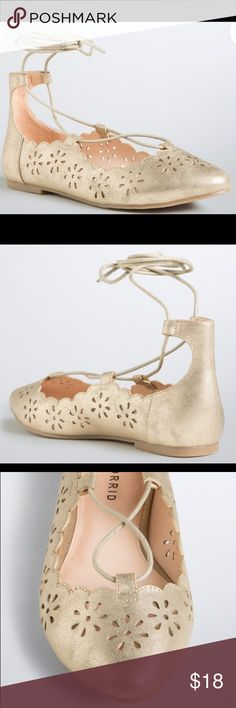 Torrid Gold Cutout Lace Up Flats Up for grabs are these pairs of shoes from Torrid. They are sizes 10W and 11W and have flat soles. These flats are gold faux leather with gold laced. They lace up the body of the foot and tie around the ankles. These flats have a scalloped edge and cutouts throughout the body. They are new with the original tag. *These sold in the store without a box, so no box is included.* torrid Shoes Flats & Loafers