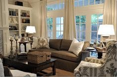 The sofa was slipcovered in a brown linen with white linen pillows.  The arm chair was covered in a Vervain brown and white linen toile.  Designer Joni Webb.