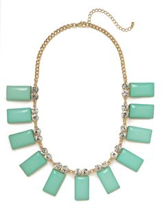 Delight in the elegant vibe of this stunning necklace, which not only features a generous dose of sparkling crystals but a lovely set of cabochon teal pendants, too. Were obsessed.