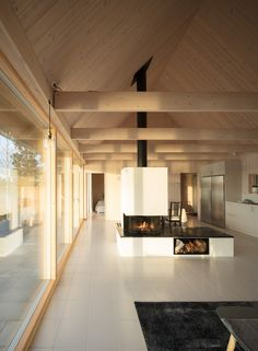 A painted-brick fireplace separates areas for living and dining at this summer house designed by London-based architect Tina Bergman for a plot looking out towards the sea on Sweden's east coast. Contemporary Cabin, Interior Design Inspiration, Interior Architecture, Ancient Architecture, Sustainable Architecture, Landscape Architecture, Building A House, Living Spaces, Living Room