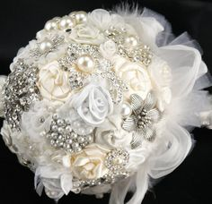 Have everyone invited to your shower bring a broach. Then make your bouquet with them - they're beautiful, they won't die and they are incredibly sentimental.
