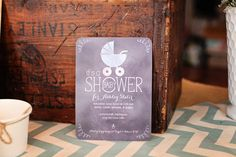 A beautiful chalkboard and rustic themed baby shower inspired by our 'Chalkboard Buggy' invitation.