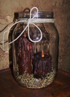 2 Grungy Primitive Folk Art Halloween Thanksgiving Harvest Candle. $16.75, via Etsy.