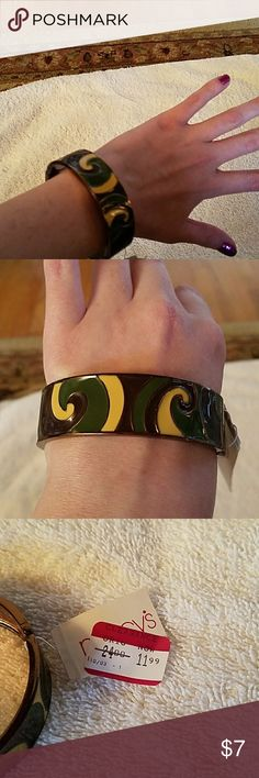 Green, yellow, & Brown bangle bracelet NWT Snaps closed, New with tags. Found this in my dresser drawer. I think I bought it to use for a Halloween costume, but as you can see in the first picture- I have little wrists and this was a little too big. Macy's Jewelry Bracelets