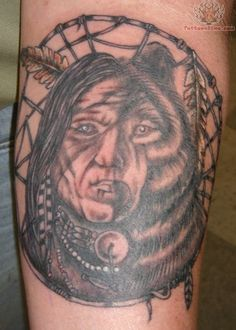 Awesome half indian half bear tattoo