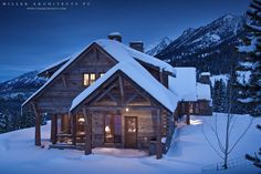 Early Dusk on a snowy cabin reflect the durability of reclaimed materials against the harsh Montana elements, by Miller Architects PC. www.ctmarchitects.com