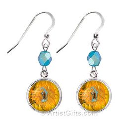 Our Van Gogh Sunflowers earrings make a nice Van Gogh gift idea and feature a close up of one of Van Gogh's Sunflowers which has a blue halo (complementary color of the background against which it stands out.) and is embellished with blue Czech Glass beads. These Van Gogh Sunflower earrings are on sterling silver French wires and have Free U.S. shipping everyday!