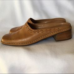 ⭐️SALE⭐️BANDOLINO Tan Leather Mules Clogs Slides 8 Vintage leather Bandolino slides / mules / clogs. Slip-on. Camel tan color. Low heel. Genuine leather uppers. Distressed leather uppers with decorative burnout and whip stitch design at the edge. Ladies shoe size 8. 🌸 BUNDLE & SAVE 20% 🌸 Bandolino Shoes Mules & Clogs