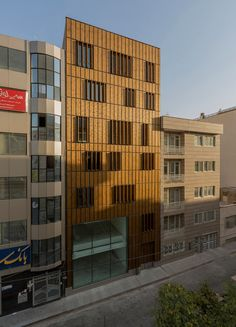 Image 10 of 19 from gallery of Saadat Abad Commercial Office Building / Mohsen Kazemianfard - fundamental approach architects. Photograph by Parham Taghioff Dezeen Architecture, Contemporary Architecture, Architecture Details, Architecture Office, Residential Architecture, Office Block, Wooden Facade, Small Buildings, Office Buildings