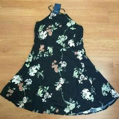 Brandy Melville Black Floral Abigail Dress Super cute dress! BNWT, printing flaw that the seller did not tell me about. (The white streak) just trying to get my money back. Brandy Melville Dresses Mini
