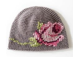 Coming up Roses Hat. Free pattern by Yarnspiration. Love the cross stitch rose on the hat.