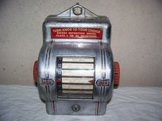 1930s nickel coin-op remote wallbox song selector for a Packard Jukebox. Note that the song titles are written in by hand!
