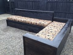Outdoor sectional furniture made with cedar, including repurposed wood from old baseboards.