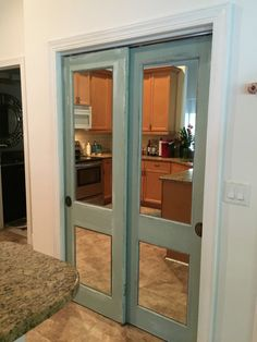 Vintage wood doors with mirror added. Refinished with Chalk paint and vintage hardware. Mirrored Closet Doors - The Glass Shoppe