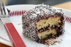Lamingtons--an Australian treat. Little cakes with chocolate frosting and shredded coconut.