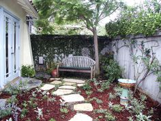 Small Yard - This relaxing courtyard features a jacaranda tree that provides light, cooling shade over the bench area.