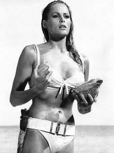 "Ursula Andress - Honey Rider     James Bond: Don't worry. I'm not supposed to be here either.  Honey Ryder: Are you looking for shells too?   James Bond: No, I'm just looking.   Ursula Andress was the first Bond girl in Dr. No, and she set the standard in many ways. There is the typical absurd and salacious name ""Honey Rider"", the looks and her role - Honey is little more than (eye)candy, but that's the point!     The opinion of many fans she is still the definite Bond girl."