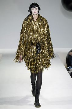 Pugh does not tame his twisted imagination for runway debut a/w 2006-7. In gold lame fringed coat.